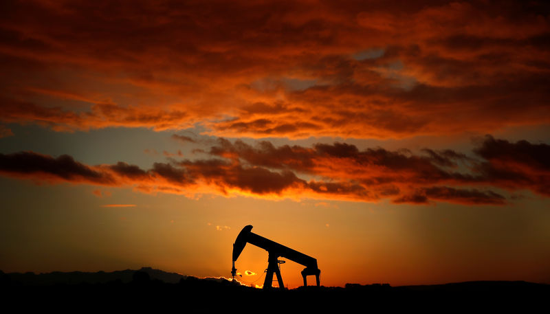 An oil pump jack is seen at sunset in a field outside Scheibenhard, near Strasbourg, France, October 6, 2017. REUTERS/Christian Hartmann