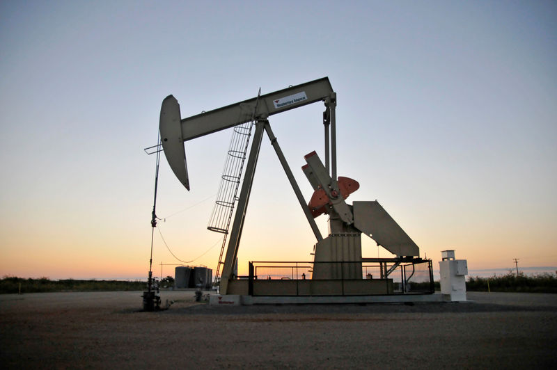 FILE PHOTO: A pump jack operates at a well site leased by Devon Energy Production Company near Guthrie, Oklahoma, U.S., September 15, 2015. REUTERS/Nick Oxford/File Photo